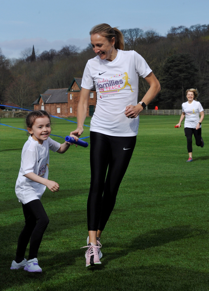 Emily Smith takes the baton from Paula Radcliffe at the launch of Families on Track in Durham
