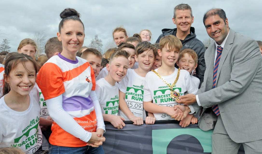 Simone Montgomery of the Grace Kelly Childhood Cancer Trust with Steve Cram, Cllr Jabba Riaz and St Barnabas pupils