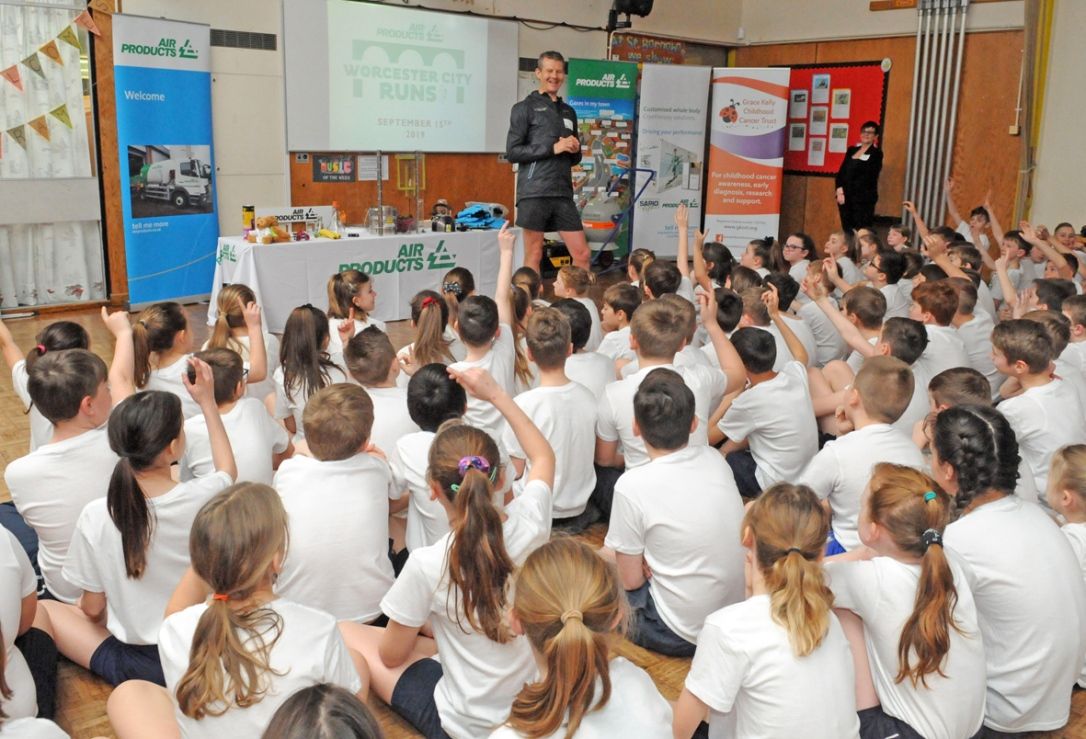 Steve Cram answers the questions of St Barnabas pupils at the launch of the 2019 Air Products Worcester City Runs