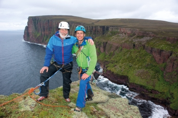 Sir Chris Bonington and Leo Houlding on the summit of the Old Man of Hoy (photo credit - Berghaus)